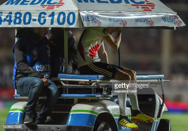 Ignacio Fernandez of River Plate leaves the field being injured during a match between San Lorenzo and River Plate as part of Superliga Argentina...