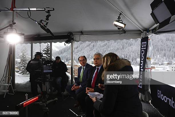 Ignacio Galan chief executive officer of Iberdrola SA left and Dr Faitih Birol executive director of the International Energy Agency centre look on...