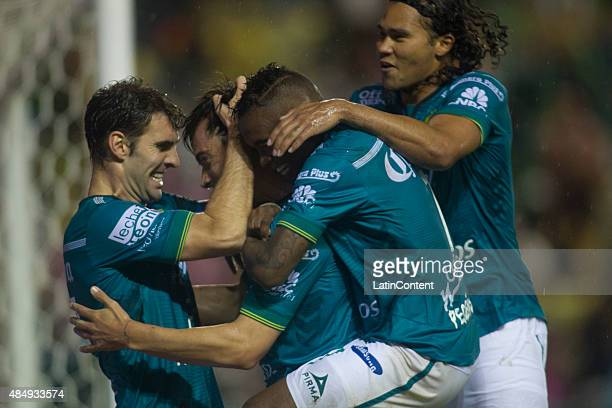 Ignacio Gonzalez of Leon celebrates with his teammate Mauro Boselli after scoring the first goal of his team during during a 6th round match between...