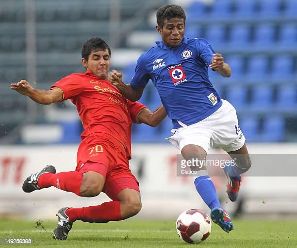 Ignacio Gonzalez of Neza FC and Cruz Azul player Maranhao fight for the ball during the Torneo Copa MX match between Cruz Azul and Neza FC at Azul...