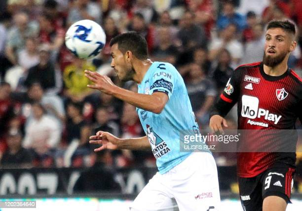 Ignacio Jeraldino of Atlas vies for the ball with Gustavo Cabral of Pachuca during the Mexican Clausura 2020 tournament football match at Jalisco...