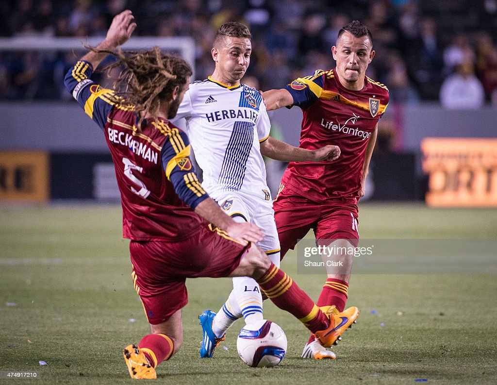 Ignacio Maganto (15) of Los Angeles tries to beat Kyle Beckerman (5) and Luis Gil (10) of Real Salt Lake during Los Angeles Galaxy's match against Real Salt Lake at the Stubhub Center on May 27, 2015 in Carson, California. The LA Galaxy won the match 1-0.