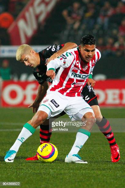 Ignacio Malcorra of Tijuana and Luis Perez of Necaxa fight for the ball during the second round match between Tijuana and Necaxa as part of Torneo...