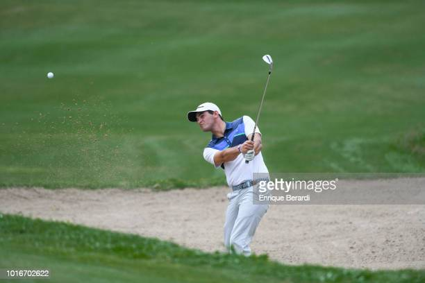 Ignacio Marino of Argentina hits out of a bunker on the 18th hole during the third round of the PGA TOUR Latinoamerica BMW Jamaica Classic at...