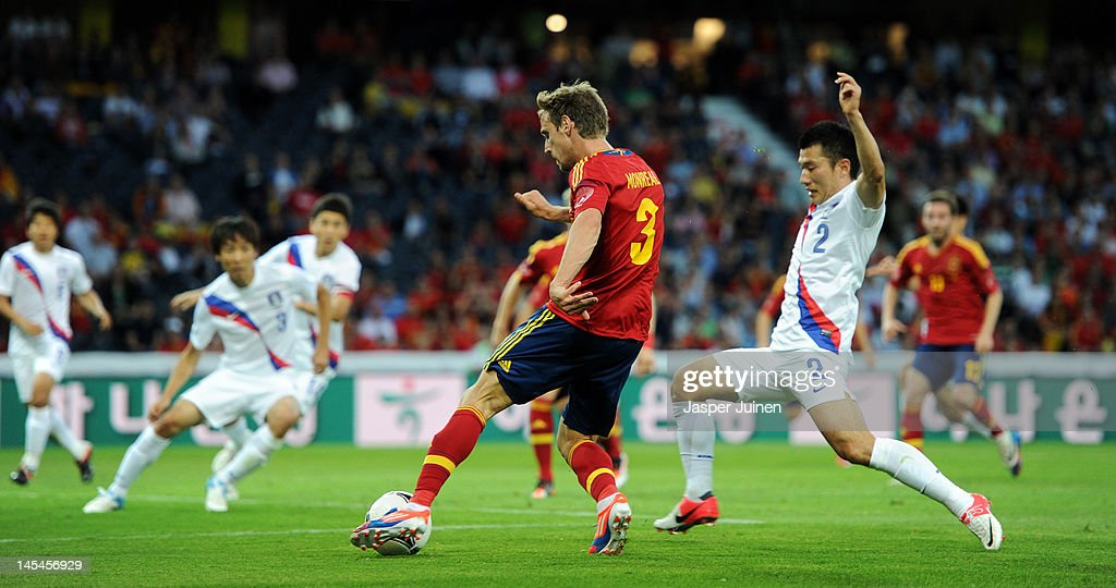 Ignacio Monreal (L) of Spain strikes the ball past Hyo Jin Choi (R) of Korea Republic during the international friendly match between Spain and Korea Republic on May 30, 2012 in Bern, Switzerland.