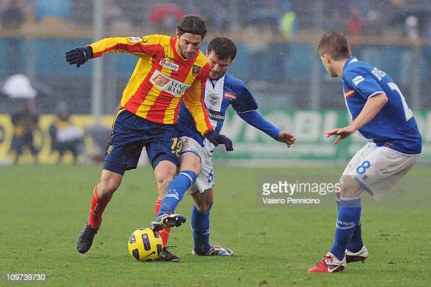 Ignacio Piatti of Lecce is challenged by Perparim Hetemaj of Brescia Calcio during the Serie A match between Brescia Calcio and Lecce at Mario...