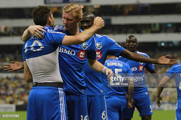 Ignacio Piatti of Montreal Impact celebrates with teammates after scoring the first goal of his team during a Championship first leg match between...