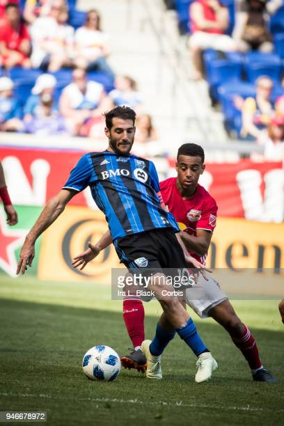 Ignacio Piatti of Montreal Impact tries to get past Red Bulls player during the Major League Soccer match between Montreal Impact and New York Red...