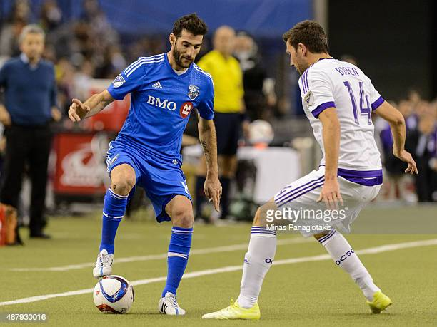 Ignacio Piatti of Montreal Impact tries to play the ball past Luke Boden of Orlando City SC during the MLS game at the Olympic Stadium on March 28...