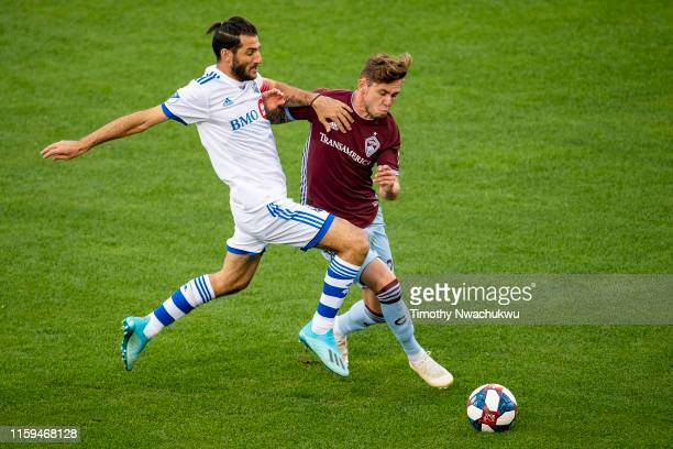 Ignacio Piatti of the Montreal Impact and Keegan Rosenberry of the Colorado Rapids battle for possession during the first half at Dick's Sporting...