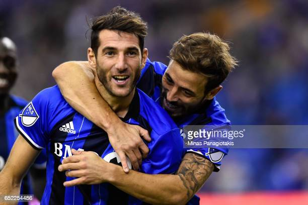 Ignacio Piatti of the Montreal Impact celebrates his goal as teammate Hernan Bernardello gives him a hug during the MLS game at Olympic Stadium on...
