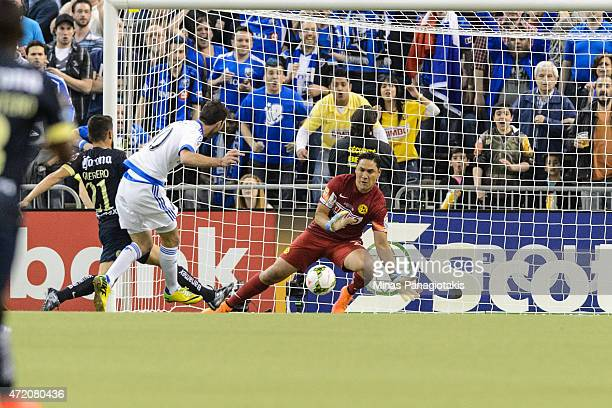 Ignacio Piatti of the Montreal Impact gets a shot on goalkeeper Moises Munoz of Club America in the 2nd Leg of the CONCACAF Champions League Final at...