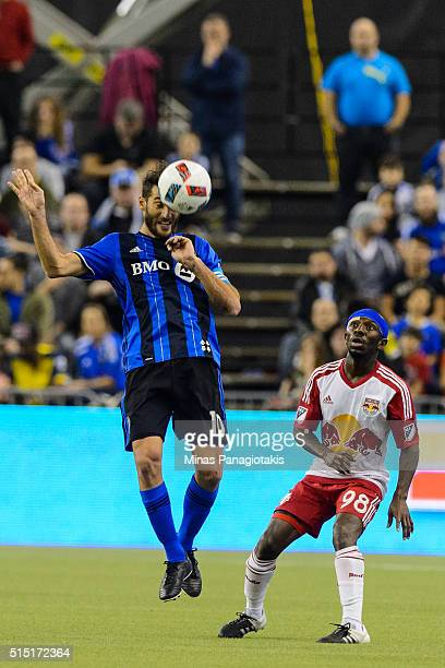 Ignacio Piatti of the Montreal Impact jumps for the ball near Shaun WrightPhillips of the New York Red Bulls during the MLS game at the Olympic...