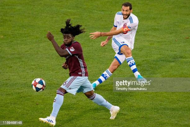 Ignacio Piatti of the Montreal Impact passes the ball past Lalas Abubakar of the Colorado Rapids during the first half at Dick's Sporting Goods Park...