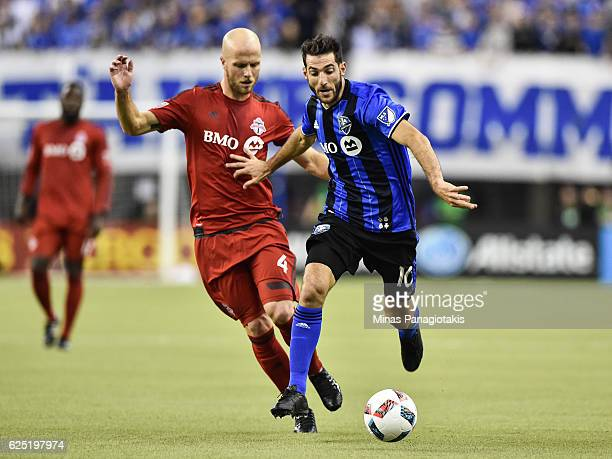 Ignacio Piatti of the Montreal Impact plays the ball past Michael Bradley of the Toronto FC during leg one of the MLS Eastern Conference finals at...