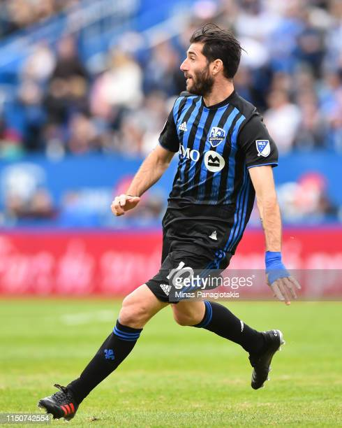 Ignacio Piatti of the Montreal Impact runs against the New England Revolution during the MLS game at Saputo Stadium on May 18 2019 in Montreal Quebec...