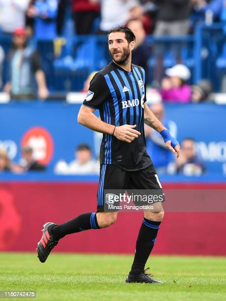 Ignacio Piatti of the Montreal Impact takes to the field in the second half against the New England Revolution during the MLS game at Saputo Stadium...