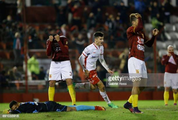 Ignacio Pussetto of Huracan celebrates the fourth goal of his team scored by Alejandro Romero Gamarra of Huracan during a second leg match between...