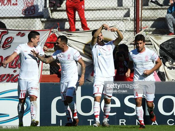 Ignacio Pussetto of Huracan celebrates with teammates after scoring the first goal of his team during a match between Huracan and Boca Juniors as...