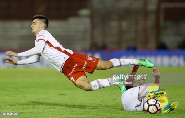 Ignacio Pussetto of Huracan fights for the ball with Luis Colmenarez of Deportivo Anzoategui during a second leg match between Huracan and Deportivo...