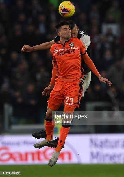 Ignacio Pussetto of Udinese battles for the ball with Merih Demiral of Juventus during the Serie A match between Juventus and Udinese Calcio at...