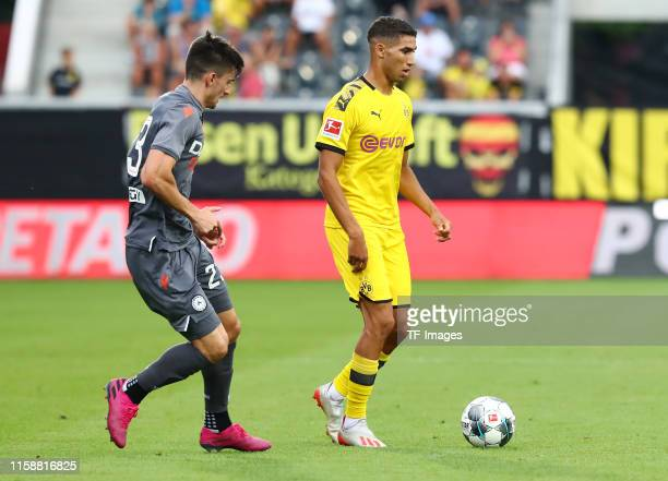 Ignacio Pussetto of Udinese Calcio and Achraf Hakimi of Borussia Dortmund battle for the ball during the preseason friendly match between Udinese...