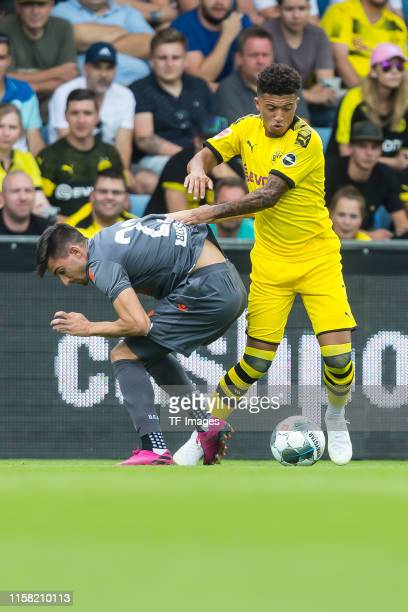 Ignacio Pussetto of Udinese Calcio and Jadon Sancho of Borussia Dortmund controls the ball during the preseason friendly match between Udinese Calcio...