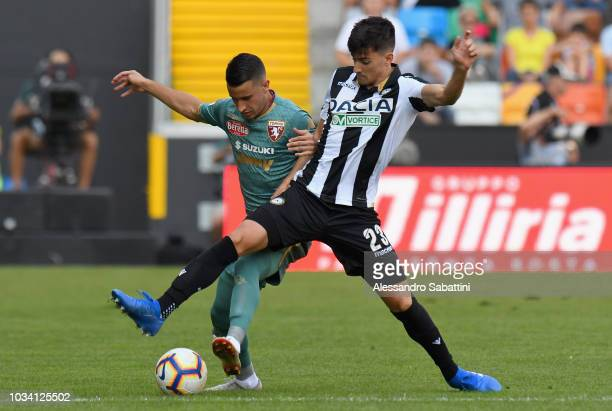Ignacio Pussetto of Udinese Calcio competes for the ball with Alejandro Berenguer of Torino FC during the serie A match between Udinese and Torino FC...
