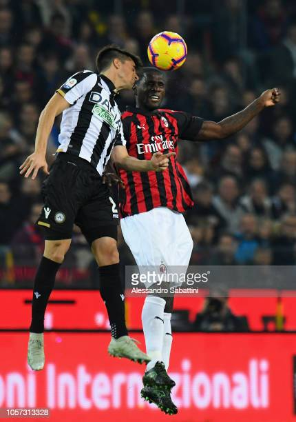 Ignacio Pussetto of Udinese Calcio competes for the ball with Christian Zapata of AC Milan during the Serie A match between Udinese and AC Milan at...