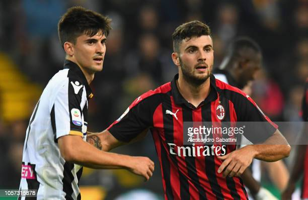 Ignacio Pussetto of Udinese Calcio competes with Patrick Cutrone of AC Milan during the Serie A match between Udinese and AC Milan at Stadio Friuli...