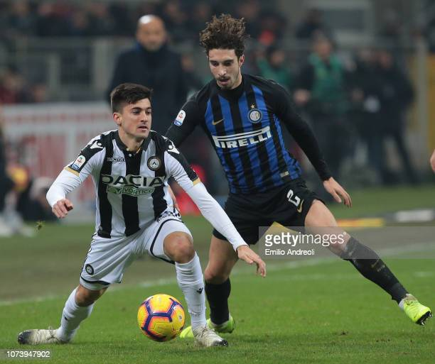 Ignacio Pussetto of Udinese Calcio is challenged by Sime Vrsaljko of FC Internazionale during the Serie A match between FC Internazionale and Udinese...