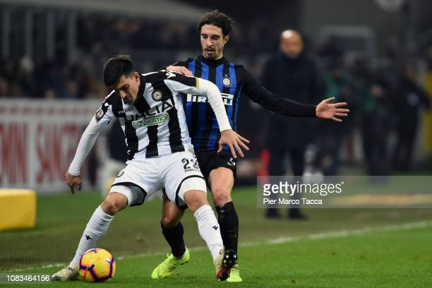Ignacio Pussetto of Udinese competes for the ball with Sime Vrsaljko of FC Internazionale during the Serie A match between FC Internazionale and...
