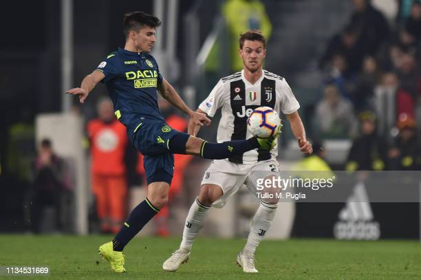 Ignacio Pussetto of Udinese controls the ball as Daniele Rugani of Juventus tackles during the Serie A match between Juventus and Udinese at Allianz...