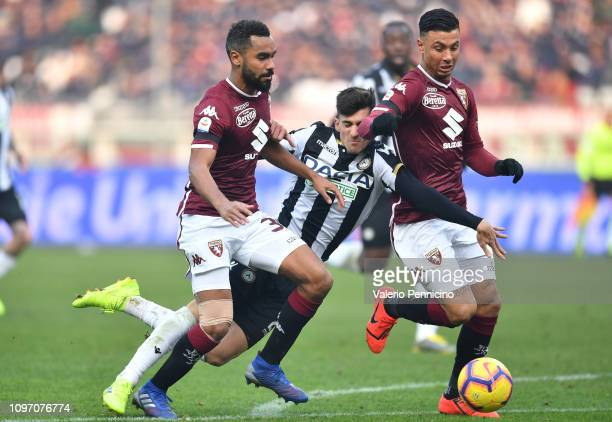 Ignacio Pussetto of Udinese is tackled by Armando Izzo of Torino FC during the Serie A match between Torino FC and Udinese at Stadio Olimpico di...