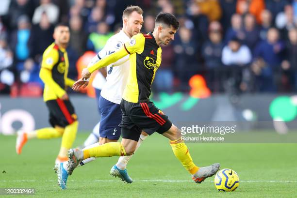 Ignacio Pussetto of Watford holds off Christian Eriksen of Tottenham during the Premier League match between Watford FC and Tottenham Hotspur at...