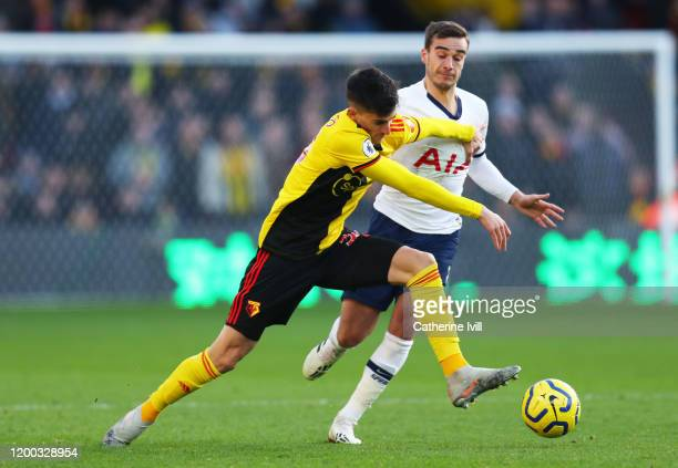 Ignacio Pussetto of Watford tackles with Harry Winks of Tottenaham Hotspur during the Premier League match between Watford FC and Tottenham Hotspur...