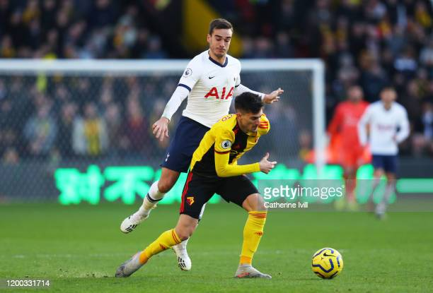 Ignacio Pussetto of Watford tackles with Harry Winks of Tottenham Hotspur during the Premier League match between Watford FC and Tottenham Hotspur at...