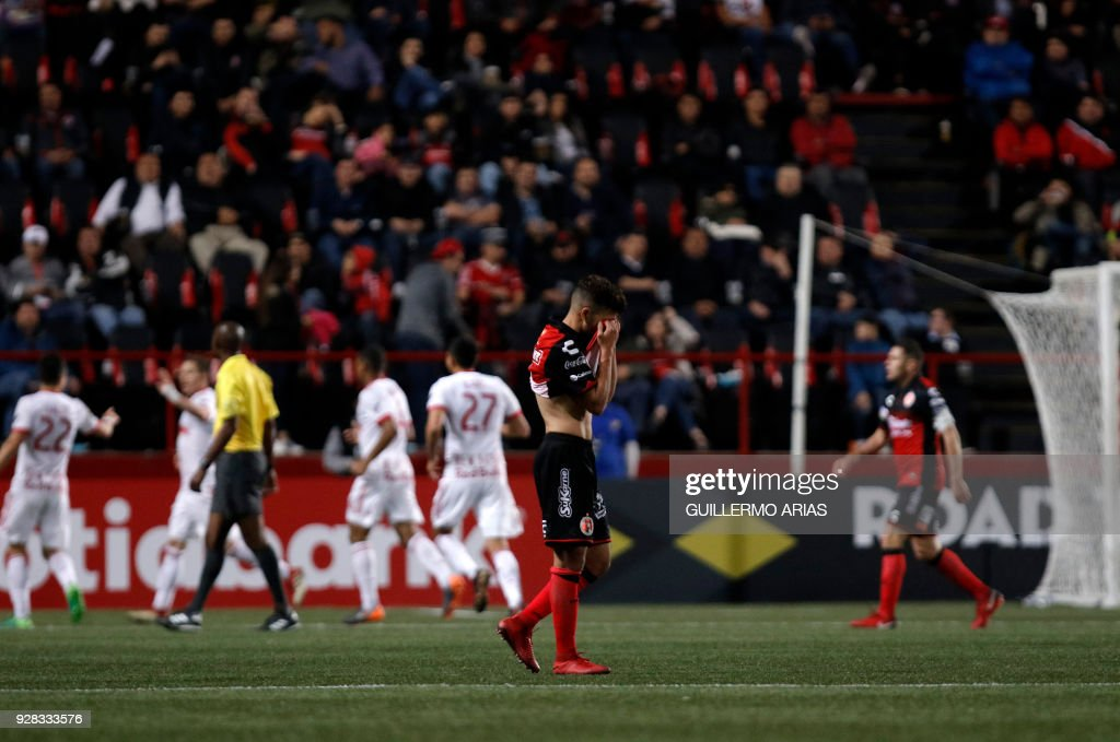 Ignacio Rivero (C) of Tijuana from Mexico reacts after his team received a goal by New York from United States during the first leg of the CONCACAF Champions League quarterfinals match at Caliente Stadium in Tijuana, Mexico on March 6, 2018. /