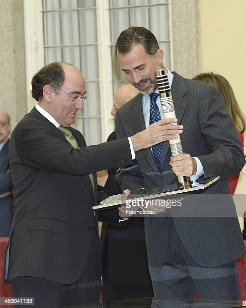 Ignacio Sanchez Galan receives from Prince Felipe of Spain the Olimpia Award during the Spanish National Sports Awards 2013 at the El Pardo Palace on...