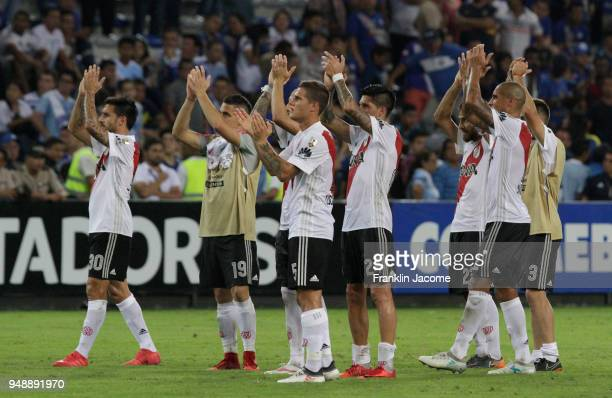 Ignacio Scocco Bruno Zuculini of River Plate and teammate greet the fans after winning a match between Emelec and River Plate as part of Copa...