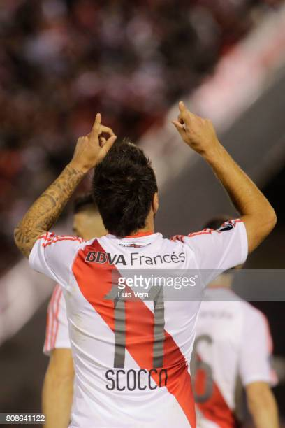Ignacio Scocco celebrates after scoring his team's first goal during a first leg match between Guarani and River Plate as part of round of 16 of Copa...