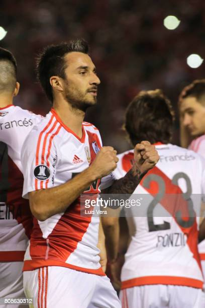 Ignacio Scocco celebrates after scoring the opening goal of his team during a first leg match between Guarani and River Plate as part of round of 16...