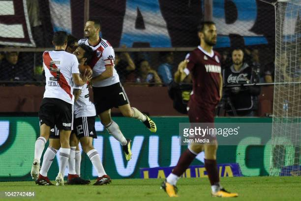 Ignacio Scocco celebrates with the teammate Rodrigo Mora a goal scored by Federico Sosa during a match between Lanus and River Plate as part of...