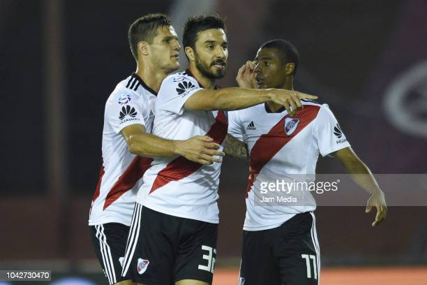 Ignacio Scocco de River Plate celebrates with the teammate Nicolas Santa Cruz after scoring his team's first goal during a match between Lanus and...