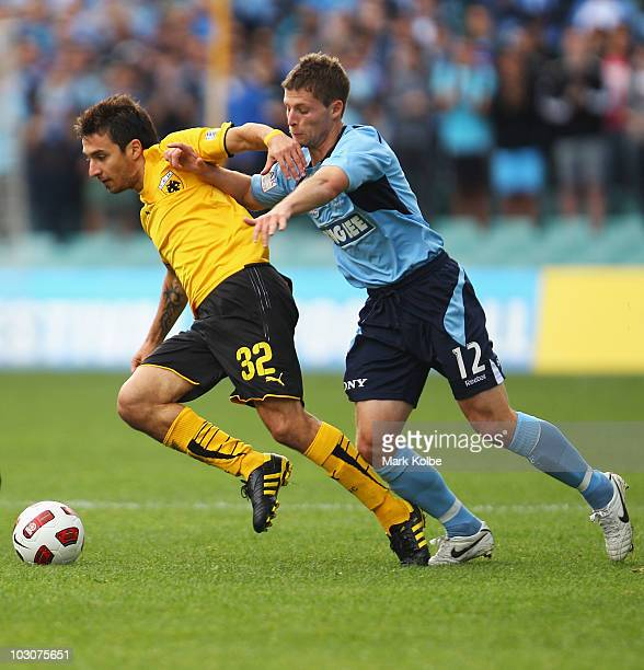 Ignacio Scocco of AEK Athens is tackled by Shannon Cole of Sydney FC during the preseason friendly match between Sydney FC and AEK Athens FC at the...