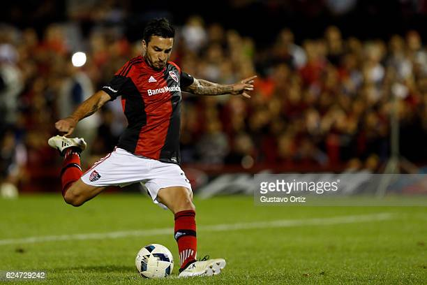 Ignacio Scocco of Newells Old Boys takes a penalty kick to score during the match between Newell's Old Boys and River Plate as part of the Torneo...