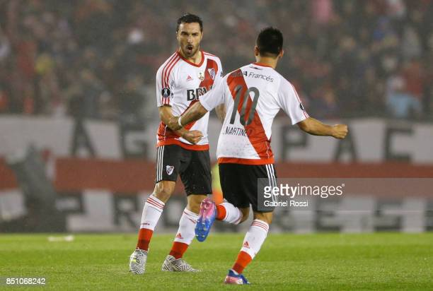 Ignacio Scocco of River Plate and teammates celebrate their team's second goal during a second leg match between River Plate and Wilstermann as part...