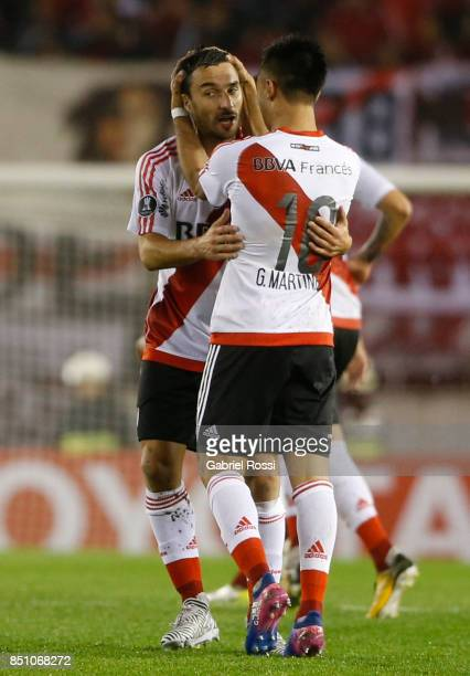 Ignacio Scocco of River Plate and teammates celebrate their team's third goal during a second leg match between River Plate and Wilstermann as part...