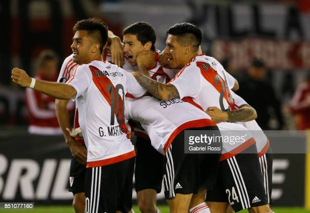 Ignacio Scocco of River Plate and teammates celebrate their team's fifth goal during a second leg match between River Plate and Wilstermann as part...