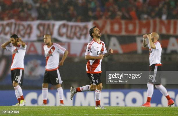 Ignacio Scocco of River Plate celebrates after scoring the first goal of his team during a second leg match between River Plate and Wilstermann as...